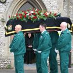 Pall Bearers Leaving Church.