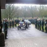 A Tractor Carries the Coffin.