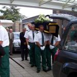 Service Personnel Carry the Coffin into the Chapel.